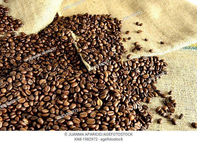 Roasted coffee beans on a coffee sack
