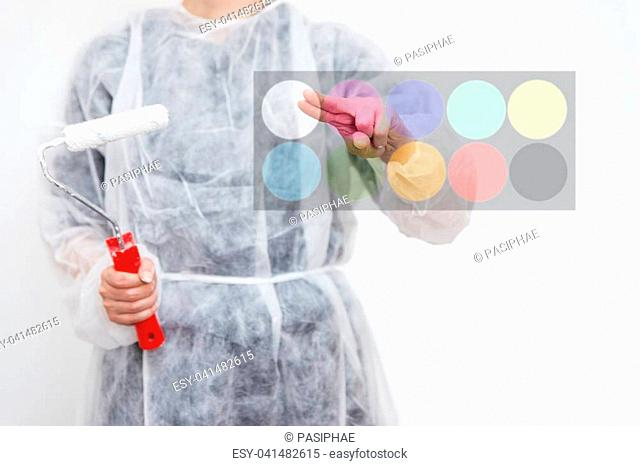 Woman with painter roller, concept of home improvement, colour decision