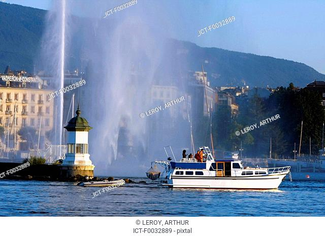 Switzerland, Geneva, little lighthouse and water-jet of the harbour