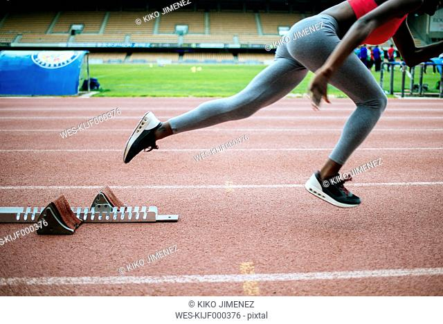 Young black athlete starting at race in stadium