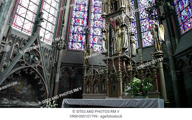 TILT up, PAN. Interior: Ambulatory, Chapel of the Sacred Heart or of St. James, Altar. The Cathedral is in the High Gothic or Classical French style