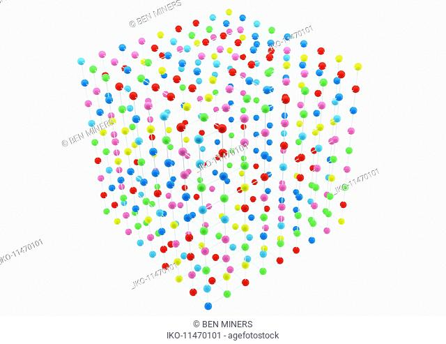 Grid arrangement of multicolored balls in cube shape on white background