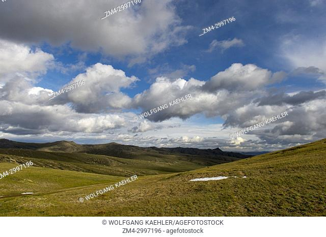 A landscape with hills and clouds in Hustain Nuruu National Park, Mongolia