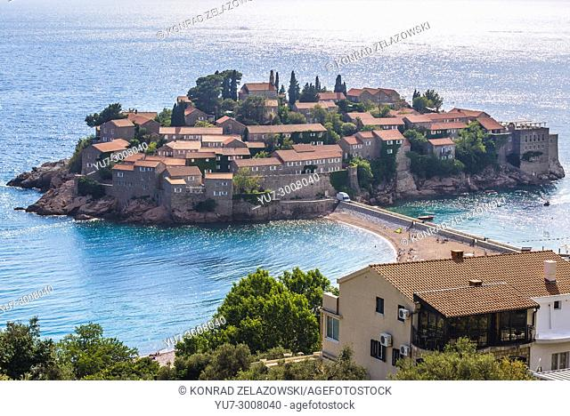 Distance view of Sveti Stefan islet and five star Aman Sveti Stefan hotel resort on the Adriatic coast of Montenegro