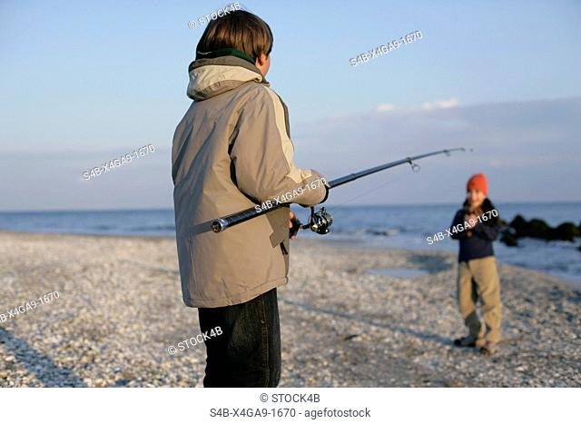 Boy holding a fishing rod