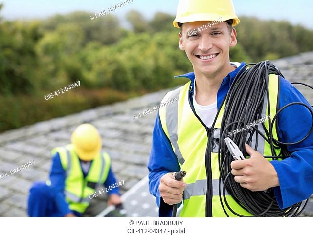 Worker smiling on rooftop