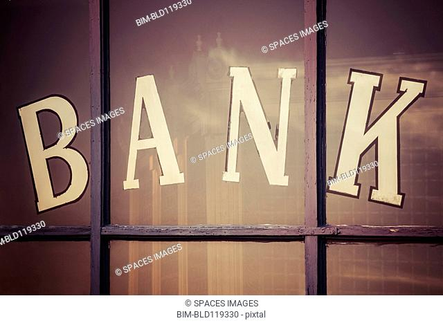 Close up of bank written on window panes