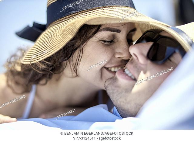 woman kissing man, holiday, summer