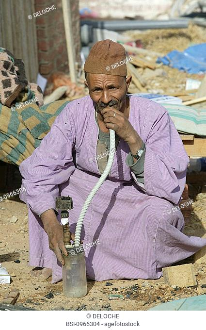 EGYPTIAN MAN<BR>Photo essay.<BR>Egyptian worker smoking chicha (water pipe) in Charm el Cheikh, Egypt