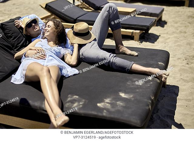 couple relaxing on sunbeds, holiday, love, summer