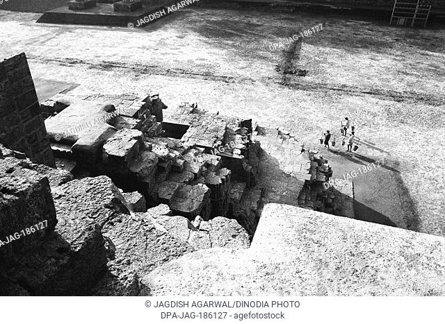 Konark temple ruins and water carriers Orissa India Asia 1977