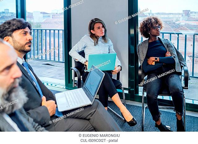 Business partners at brainstorming meeting in office