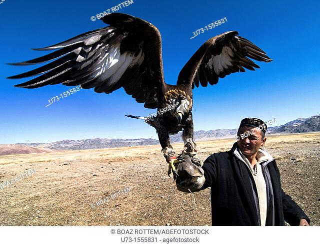 A Kazakh eagle hunter showing with pride his beautiful Golden Eagle