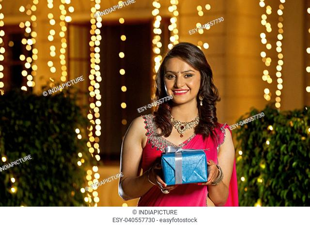 Portrait of a woman holding gift