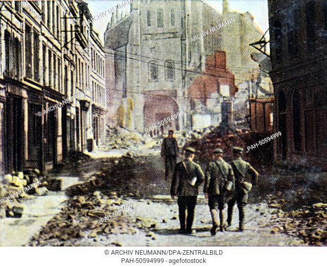 The contemporary colorized German propaganda photo shows German soldiers in front of the destroyed St. Quentin Basilica along the Siegfried Front (from Arras...