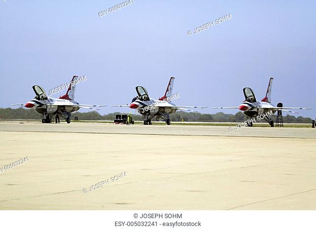 Three F-16C Fighting Falcons, known as the Thunderbirds, resting on the Tarmac with their cockpits open at the 42nd Naval Base Ventura County NBVC Air Show at...