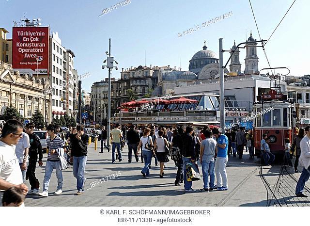 Taksim Square, historic tram, crowded with people, Beyoglu, Istanbul, Turkey