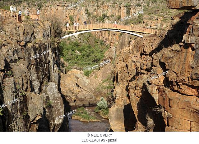 Elevated View of Tourists Standing on a Bridge Over Bourke's Luck Potholes  Mpumalanga Province, South Africa