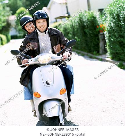 A couple on a scooter