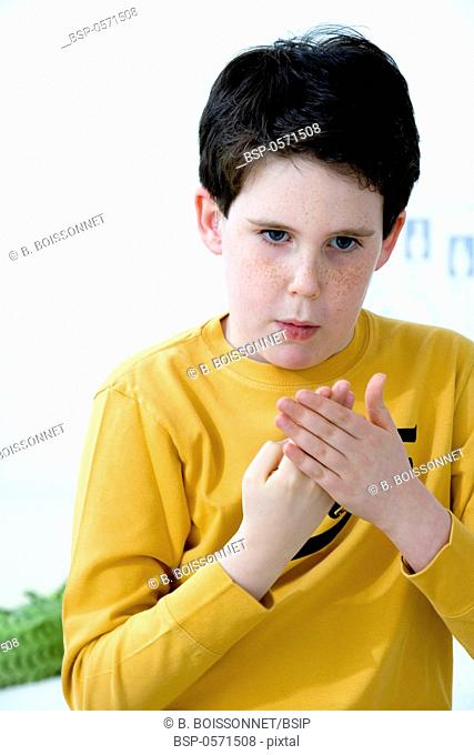 SIGN LANGUAGE Model. Do not use for HIV. A young hearing-impaired boy using the French sign language. The French sign language uses signs to designate words but...