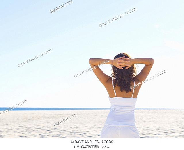 Mixed race woman relaxing on beach