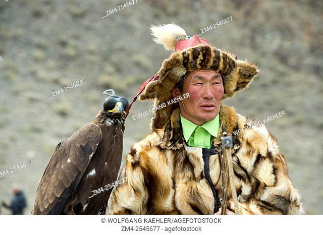 Portrait of Kazakh eagle hunter at the Golden Eagle Festival on the festival grounds near the city of Ulgii (Ölgii) in the Bayan-Ulgii Province in western...
