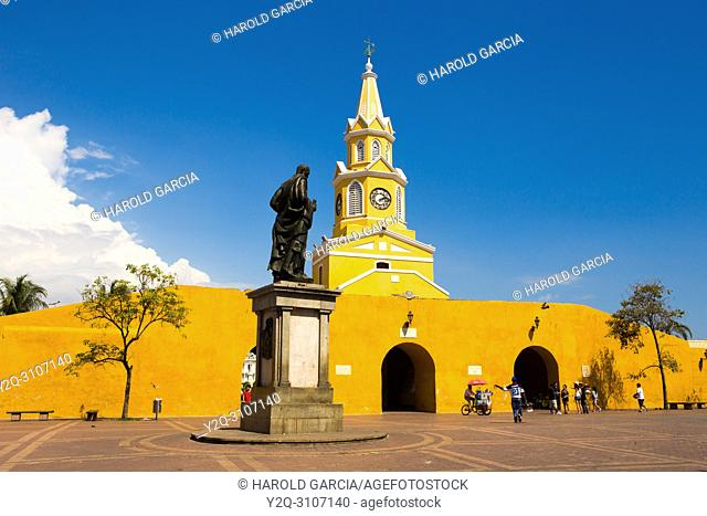 View to the cathedral with clock tower in the historic center with the statue of Pedro De Heredia in the foreground, Cartagena de Indias, Bolivar , Colombia
