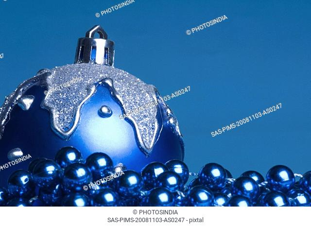 Blue bauble with a string of blue beads