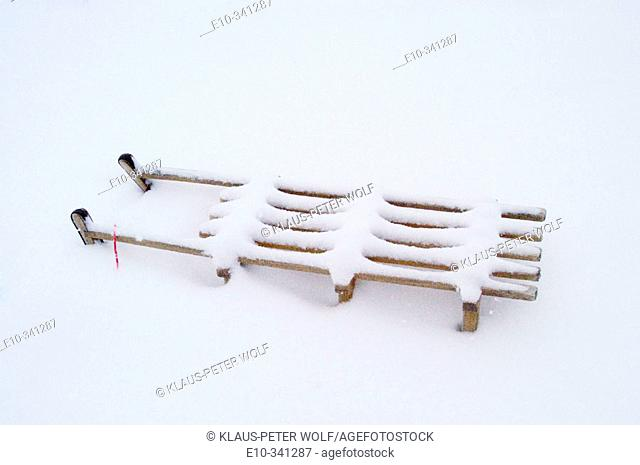 Snow covered sledge