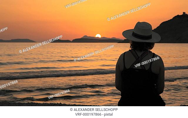 MS, Lockdown, Two women sitting by the sea at sunset