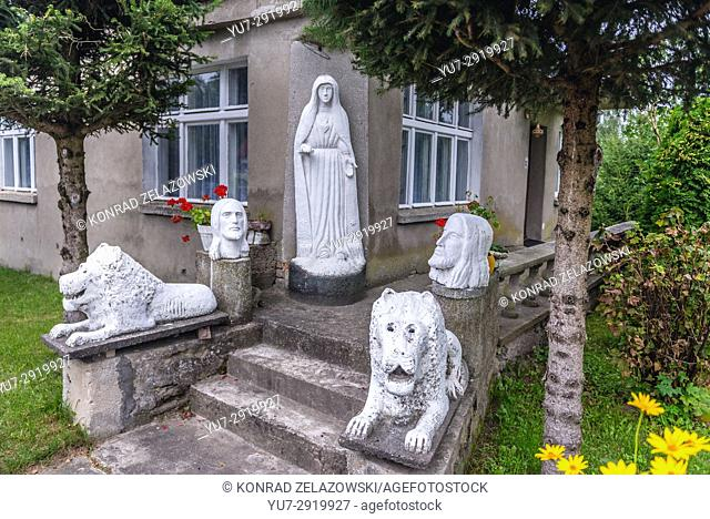 Stone sculptures in front of the house in Lesno village, Chojnice County on Kashubia region of Pomeranian Voivodeship in Poland