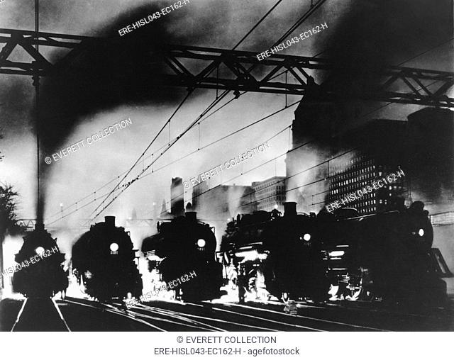 Five steam locomotives, side by side, outbound from Chicago at dusk, c. 1940 (BSLOC-2016-10-179)