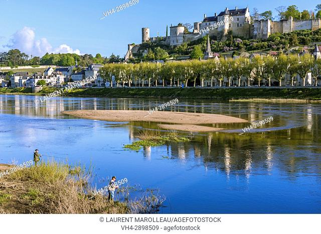 Fishermen on the banks of Vienne River, the City and the Royal Fortress of Chinon. Indre-et-Loire, Central Region, Loire Valley, France, Europe