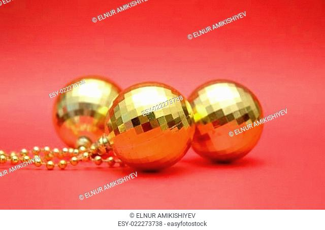 three golden balls on the red background