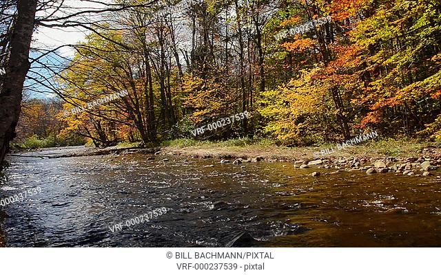 Jackson New Hampshire river flowing in White Mountains National Forest in Northern New England in fall foliage in October