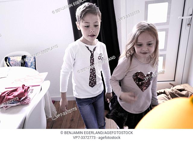 brother and sister playing with balloon
