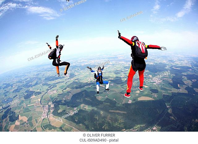 Three skydivers free falling above Leutkirch, Bavaria, Germany