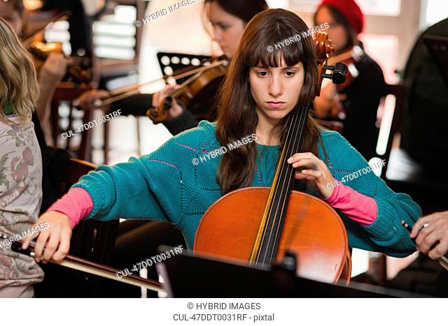 Cello player practicing with group
