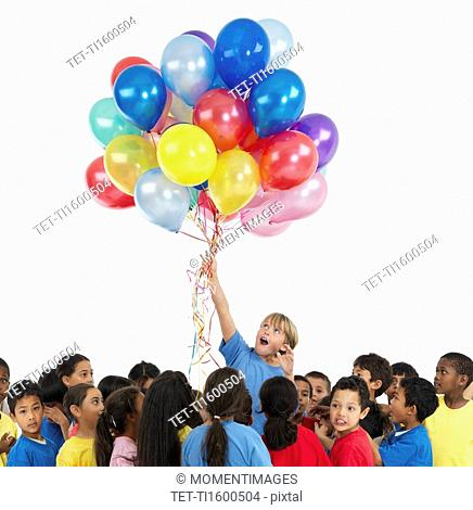 Children and balloons
