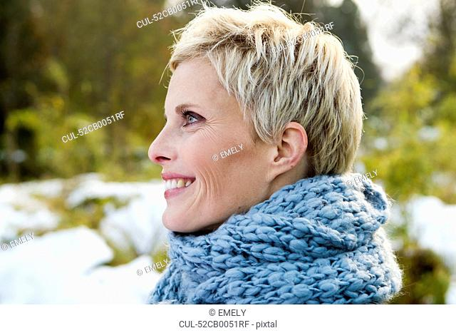 Woman wearing knitted scarf outdoors