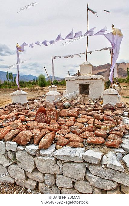 Mani stones (Tibetan Buddhist prayer stones) at a shrine in Leh, Ladakh, India. - LEH, LADAKH, INDIA, 12/07/2010