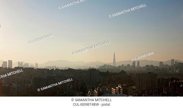 Hazy cityscape and skyline at dusk, Seoul, South Korea
