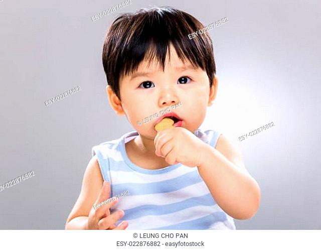 Asian boy eating snack