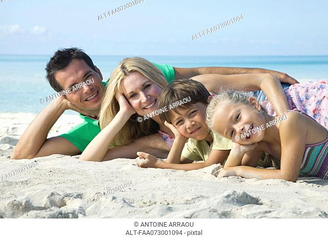Family posing together at the beach, portrait