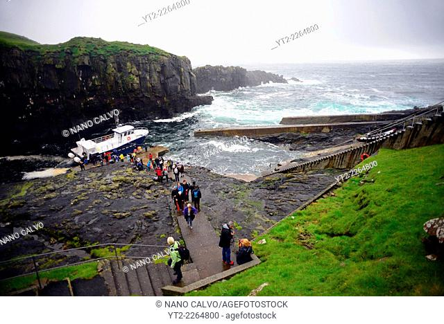 Visitors arrive at Mykines island in ferry called Jósup, Faroe Islands