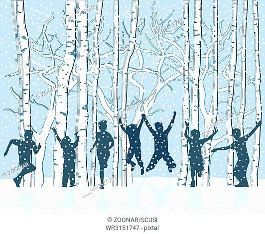 Children in snowy winter landscape are cheerful