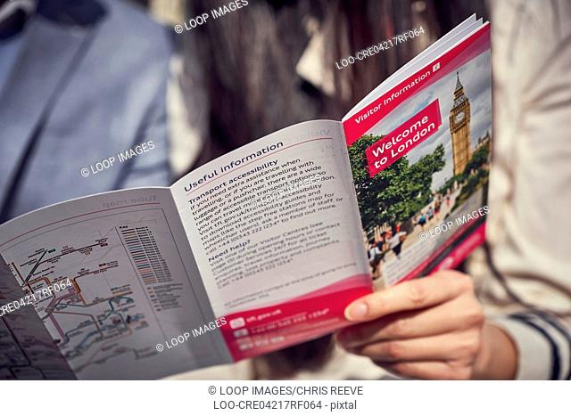 A tourist holds a map of London