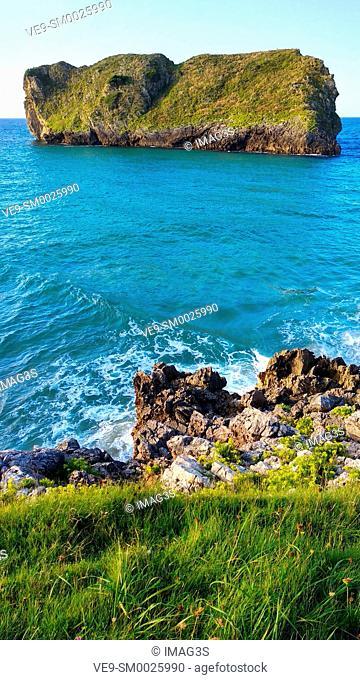 Almenada island, also known as Poo island, shore between Poo and Celorio villages, Llanes municiplity, Asturias, Spain