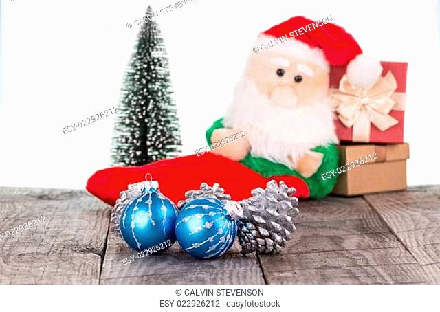 Christmas baubles and Santa Claus toy background