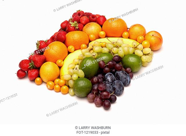 Various fresh fruits arranged into the shape of square